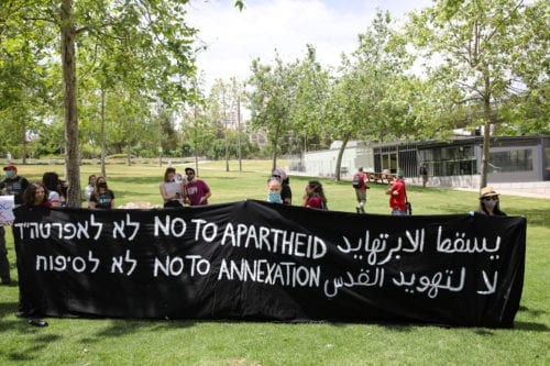 A group of Israeli activists, holding banners, gather in front of U.S Embassy as they stage a demonstration to protest against the annexation plan of Jordan Valley, and illegal Jewish settlements in West Bank, on May 15, 2020 in Jerusalem [Mostafa Alkharouf - Anadolu Agency]