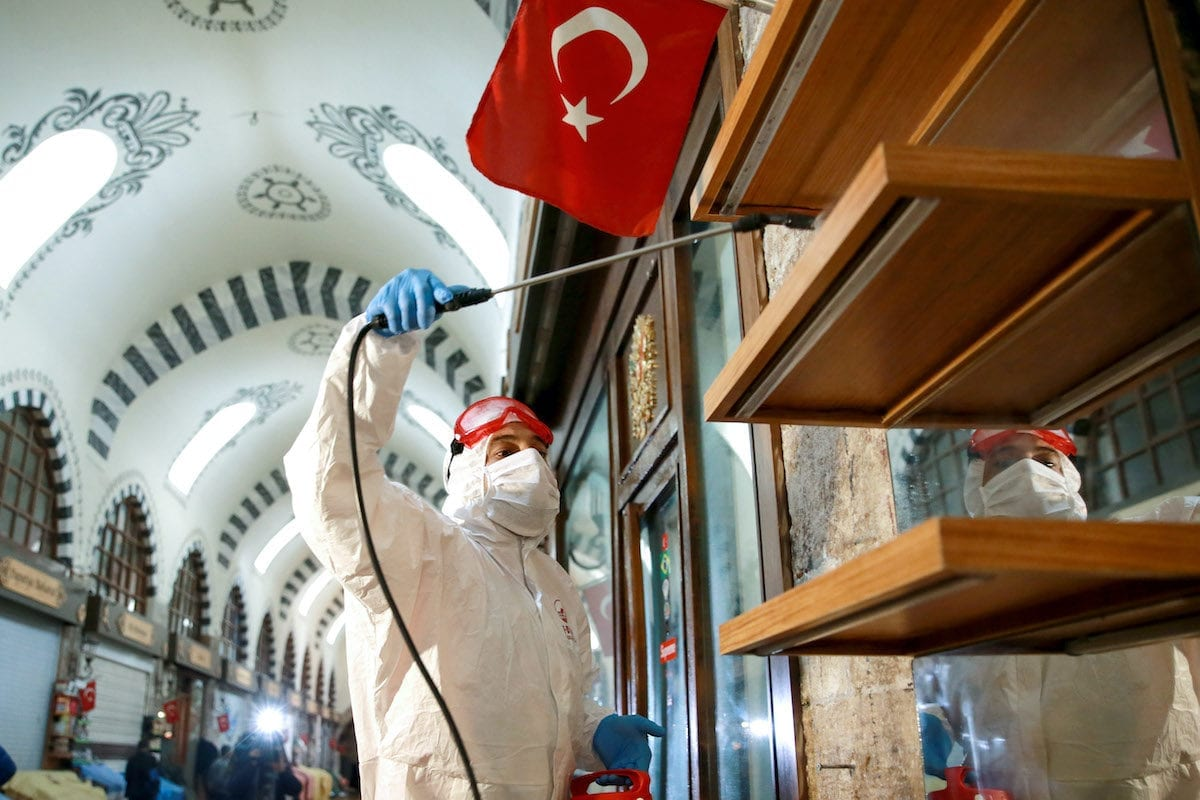 Municipal workers conduct cleaning and disinfection works at Historic Egyptian Bazaar in Istanbul, Turkey on 28 May, 2020 [Ahmet Bolat/Anadolu Agency]