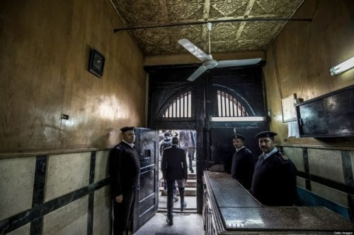 Egyptian policemen at the entrance of a prison in the Egyptian capital Cairo, 27 May 2020 [KHALED DESOUKI/AFP/Getty Images]