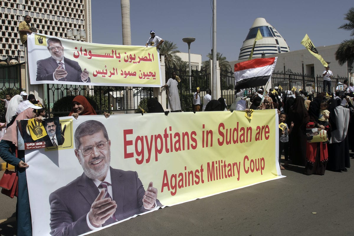 Supporters of the Muslim Brotherhood and of ousted president Mohamed Morsi rally outside the Egyptian Embassy in Khartoum on 4 November 2013. [ASHRAF SHAZLY/AFP via Getty Images]