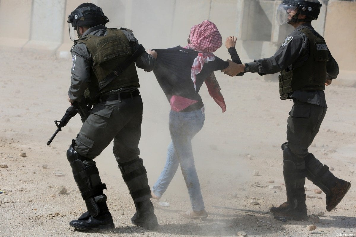 Israeli border guards detain a Palestinian protester during clashes following a demonstration by students from Birzeit University near Ramallah against the incarceration in Israeli jails of Palestinian university students, on March 10, 2015 in the West Bank village of Betunia, outside the Israeli-run Ofer prison. [ABBAS MOMANI/AFP via Getty Images]