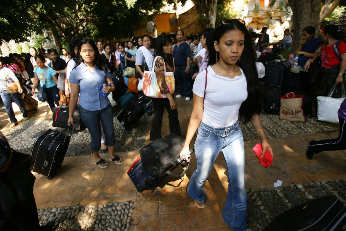 Filipino nationals gather at the French embassy in Beirut before their evacuation from war-torn Lebanon, 23 July 2006 [NICOLAS ASFOURI/AFP via Getty Images]