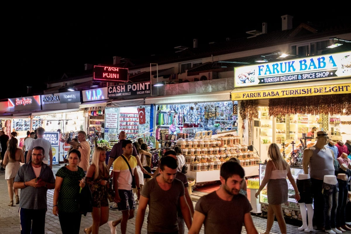 Tourists are seen shopping on a street on September 6, 2017 in Oludeniz, Turkey [Chris McGrath/Getty Images]