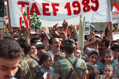 People come together following the Taif agreement on 4 November 1989 in Beirut, Lebanon [JOSEPH BARRAK/AFP/Getty Images]