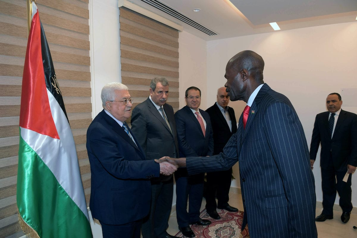 Palestinian President Mahmoud Abbas receives the credentials of the Ambassador of Kenya to the State of Palestine, in Amman on 17 December 2018. [Thaer Ganaim/Apaimages]