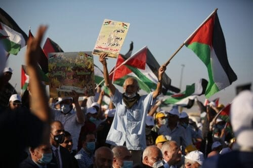 Palestinians gather to stage a protest against and Israel's annexation plans in the West Bank on 22 June 2020 [Issam Rimawi/Anadolu Agency]
