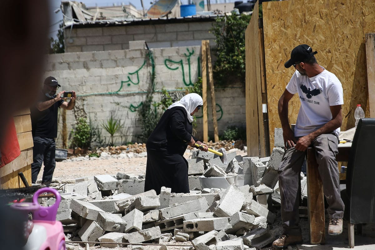 A Palestinian family was forced by Israeli authorities to demolish their own home to avoid paying demolition fees in Jerusalem on 2 May 2020 [Alkharouf/Anadolu Agency]