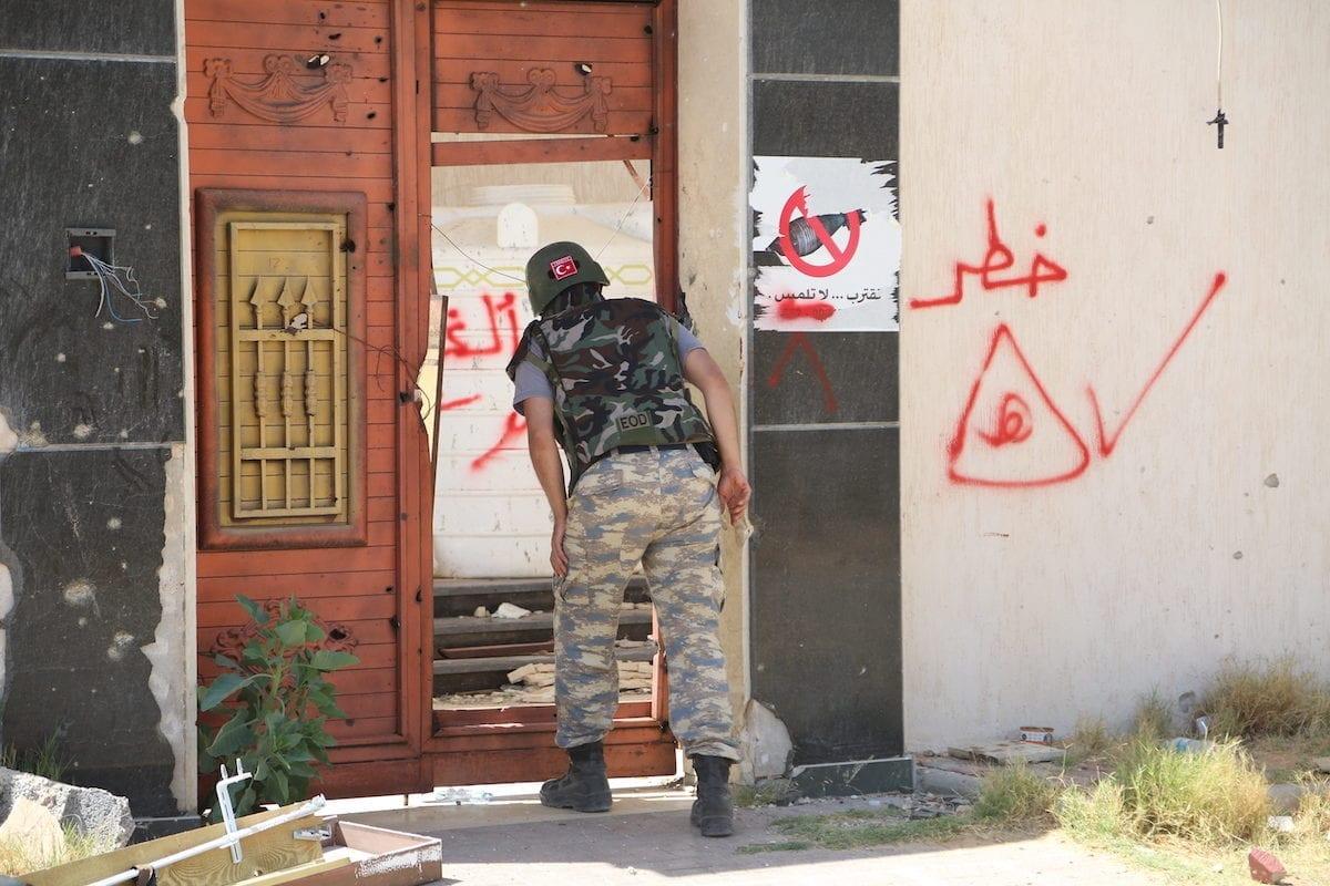 Warnings of mines written on walls following Khalifa Haftar placed bombs in them in Tripoli, Libya on 15 June 2020 [Enes Canlı/Anadolu Agency]