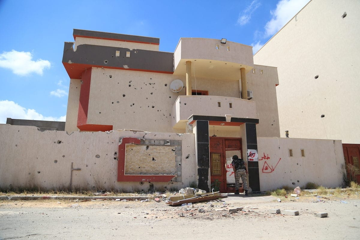 Warnings of mines written on walls after Khalifa Haftar's forces planted bombs in them in Tripoli, Libya on 15 June 2020 [Enes Canlı/Anadolu Agency]