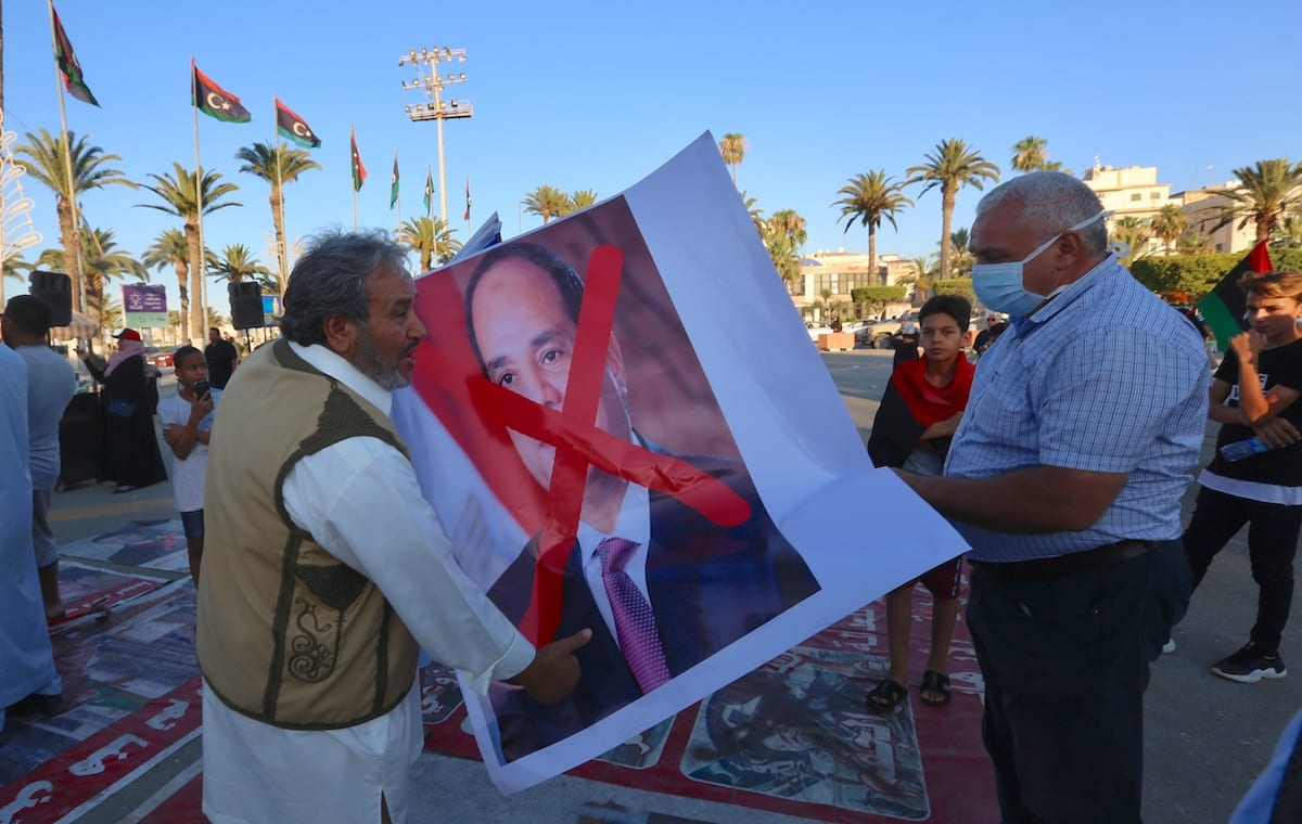 People carry a crossed out image of President of Egypt Abdel-Fattah Al-Sisi during a protest against him following his intervention threat at Martyrs Square in Tripoli, Libya on 21 June 2020. [Hazem Turkia - Anadolu Agency]