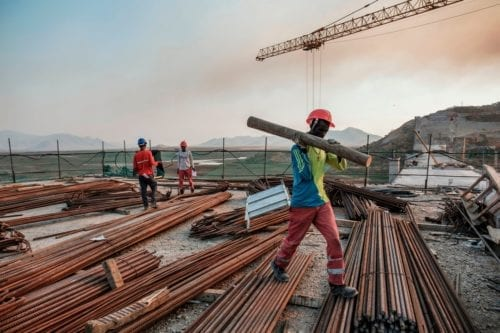 Workers at the Grand Ethiopian Renaissance Dam in Ethiopia on 26 December 2019 [EDUARDO SOTERAS/AFP/Getty Images]