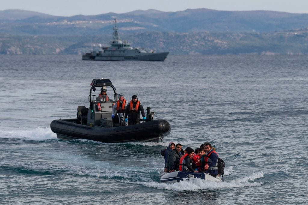 A dinghy with 15 Afghan refugees, 5 children, 3 women and 7 men, approaches the Greek island of Lesbos on 28 February, 2020 [ARIS MESSINIS/AFP via Getty Images]