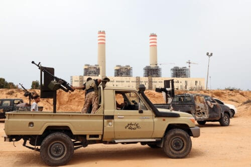 Forces loyal to Libya's UN-backed unity government are seen in front of a power plant they have captured from the Islamic State (IS) group around 23 kilometres (14 miles) west of Sirte on June 2, 2016. [MAHMUD TURKIA/AFP via Getty Images]