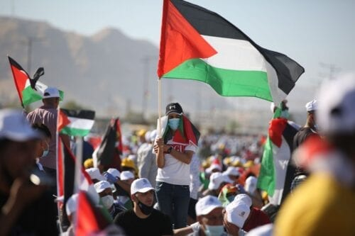 Palestinians gather to stage a protest against Jewish settlements and Israel's annexation plan of Jordan Valley in Jericho, West Bank on June 22, 2020 [Issam Rimawi / Anadolu Agency]