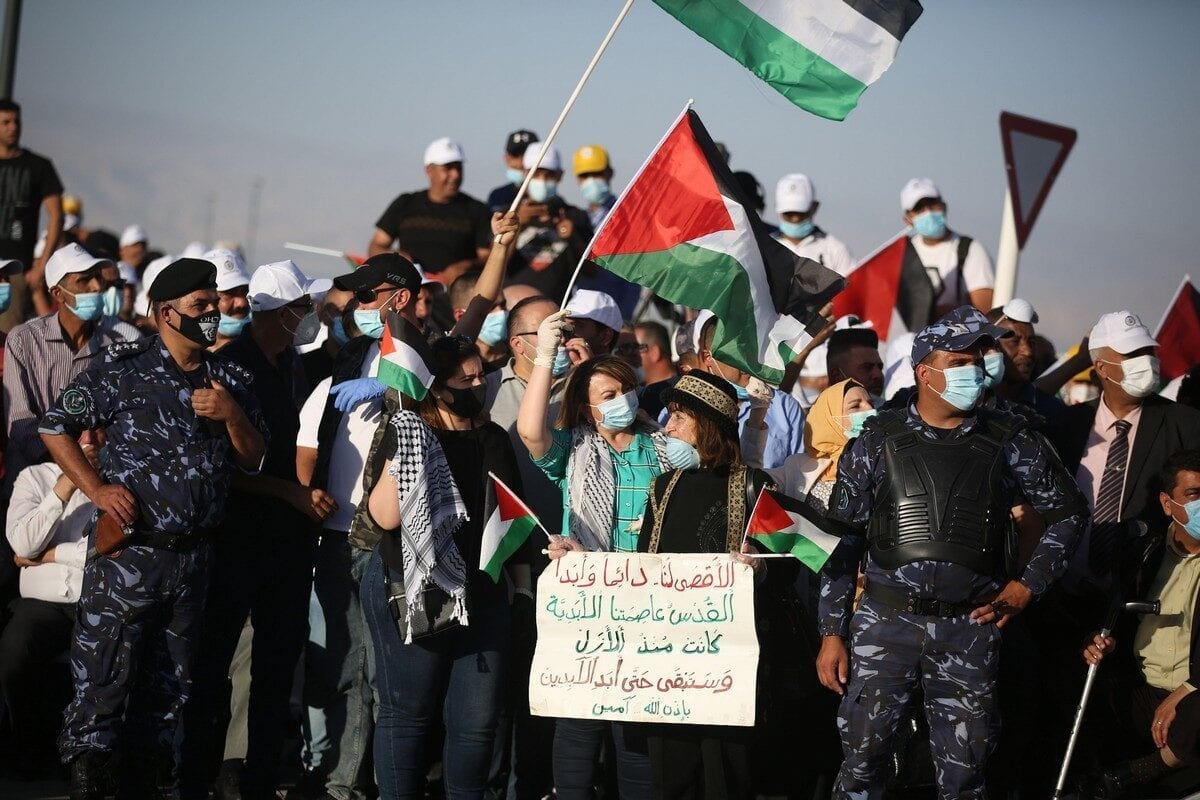 Palestinians gather to stage a protest against Jewish settlements and Israel's annexation plan of Jordan Valley in Jericho, West Bank on 22 June 2020. [Issam Rimawi - Anadolu Agency]