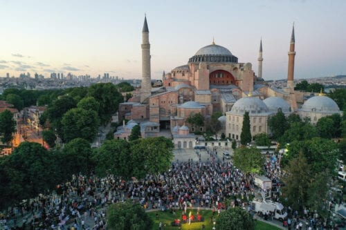 A drone photo shows people gathered to perform the evening prayer at Ayasofya (Hagia Sophia) Square after the 10th Chamber of the Council of State's decision of the annulment of a 1934 Cabinet decision making Hagia Sophia – previously a mosque for nearly 500 years – into a museum, in Istanbul, Turkey on 10 July 2020. [Muhammed Enes Yıldırım - Anadolu Agency]