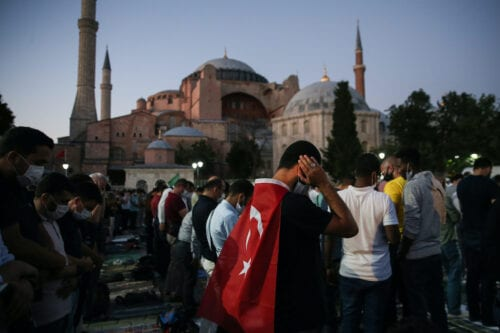 People perform the evening prayer at Ayasofya (Hagia Sophia) Square after the 10th Chamber of the Council of State's decision of the annulment of a 1934 Cabinet decision making Hagia Sophia – previously a mosque for nearly 500 years – into a museum, in Istanbul, Turkey on July 10, 2020. [Emrah Yorulmaz - Anadolu Agency]
