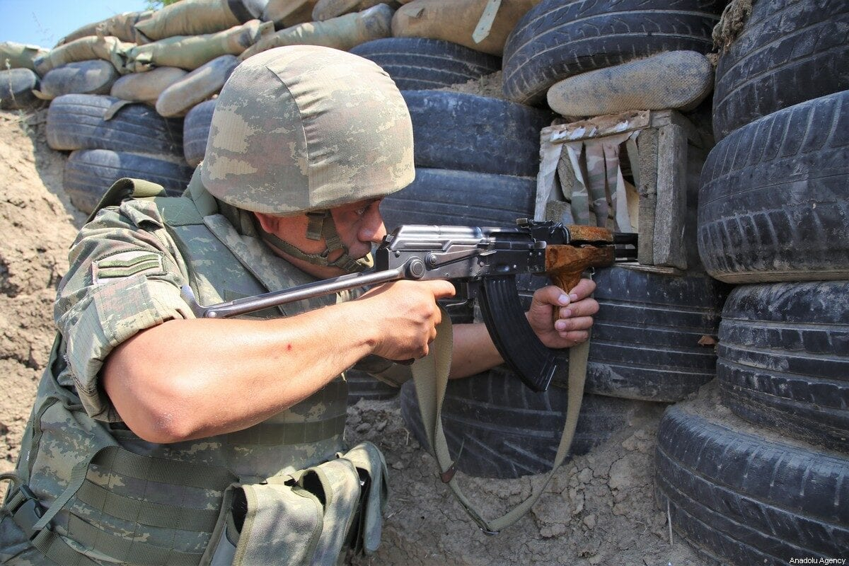 An Azerbaijani soldier is on alert as Azerbaijani soldiers patrol to respond to possible new attacks while tensions continue on July 18, 2020 [Resul Rehimov - Anadolu Agency]