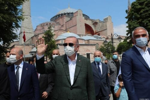 President of Turkey Recep Tayyip Erdogan (C) salutes public after a visit to inspect Hagia Sophia Mosque which will be opened on 24th of July for worship after 86 years with Friday prayer, in Istanbul, Turkey on 19 July 2020. [TUR Presidency Murat Cetinmuhurdar - Anadolu Agency]