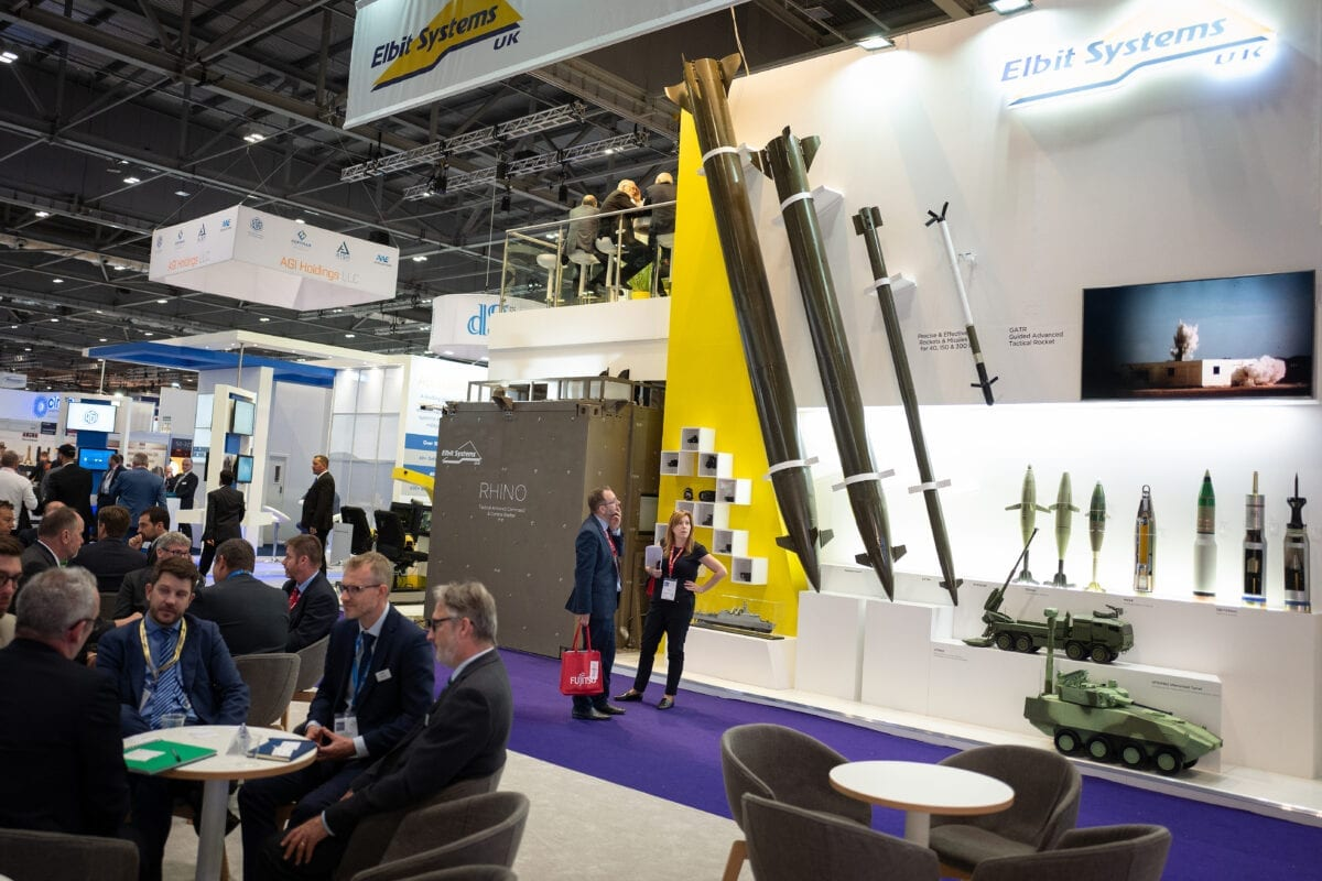 A man looks at a display of rockets from Elbit Systems UK including the Predator Hawk (L) and the Extra (2L) as delegates enjoy drinks at the end of day one of the DSEI arms fair at ExCel on September 10, 2019 [Leon Neal/Getty Images]