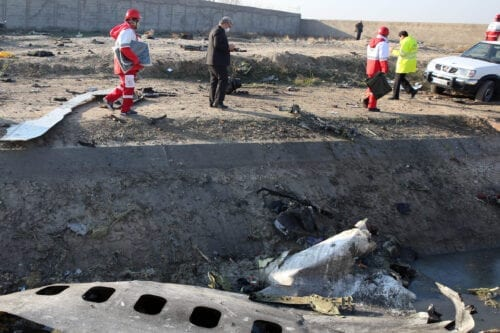 Rescue teams recover debris from a field after a Ukrainian plane carrying 176 passengers crashed near Imam Khomeini airport in the Iranian capital Tehran early in the morning on January 8, 2020, killing everyone on board [-/AFP via Getty Images]