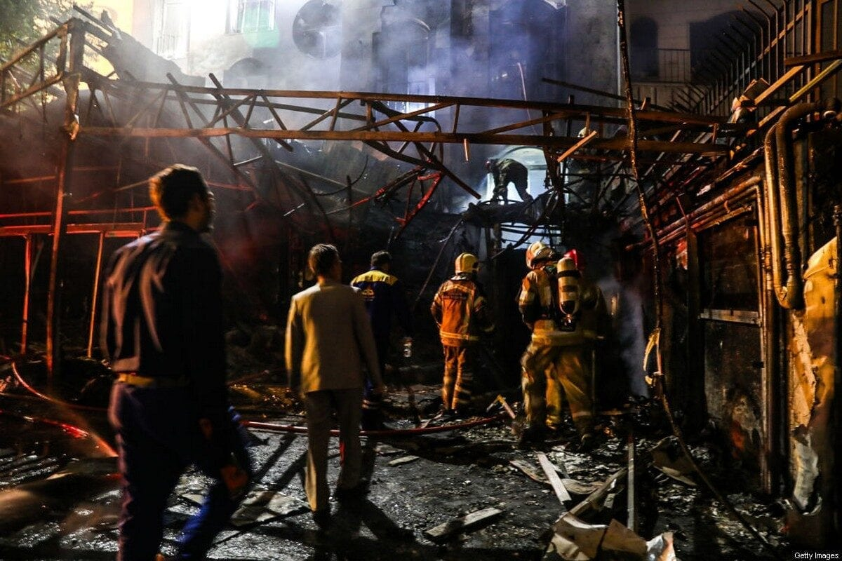 First responders gather at the scene of an explosion at the Sina At'har health centre in the north of Iran's capital Tehran northern Tehran on June 30, 2020 [AMIR KHOLOUSI/ISNA/AFP via Getty Images]