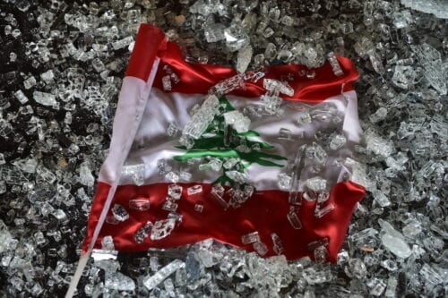 Lebanese flag is seen in the rubble after the explosion on August 5, 2020 [Houssam Shbaro/Anadolu Agency]