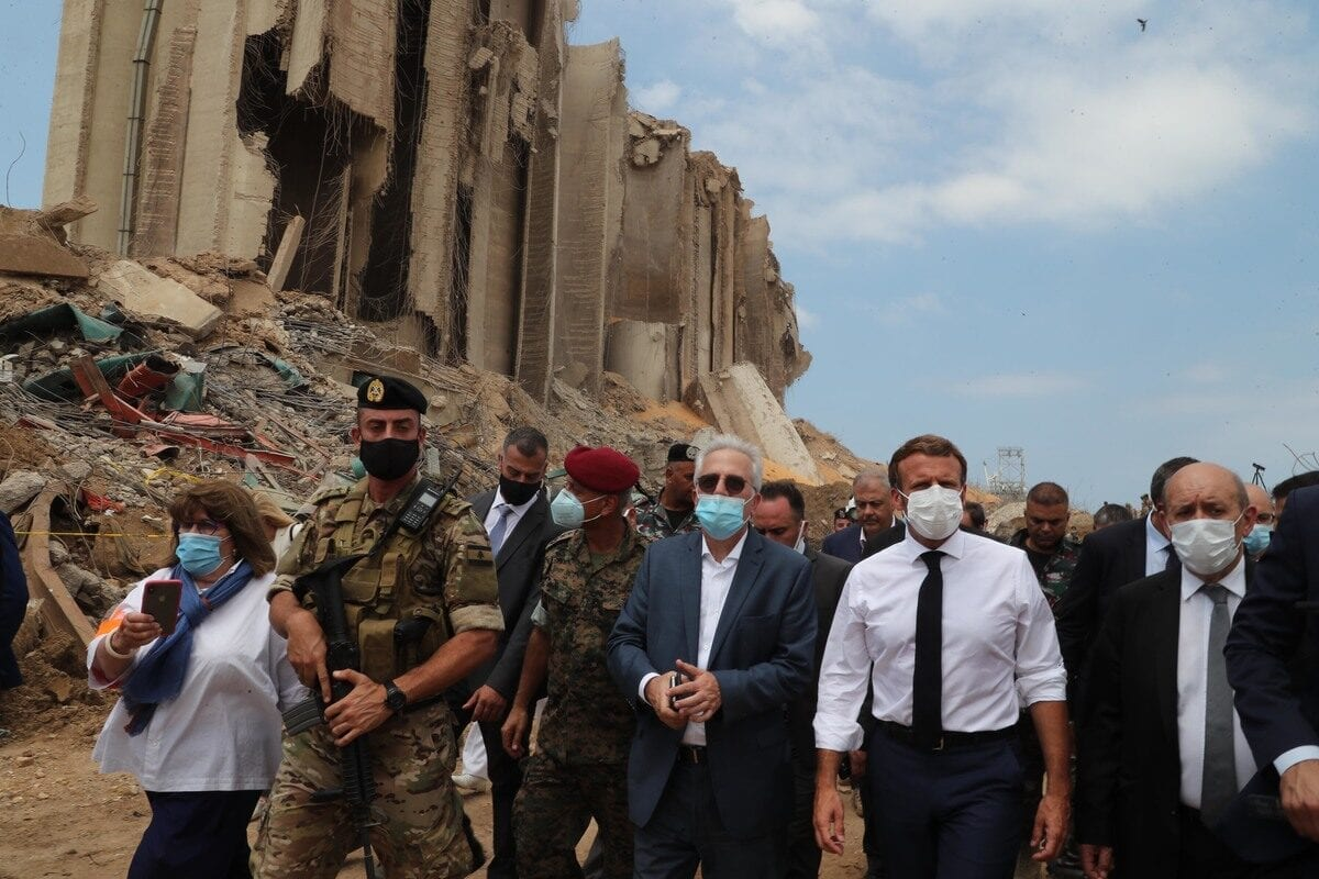 French President Emmanuel Macron inspects the site after a fire at a warehouse with explosives at the Port of Beirut led to massive blasts in Beirut, Lebanon on 6 August 2020. [LEBANESE PRESIDENCY / HANDOUT - Anadolu Agency]