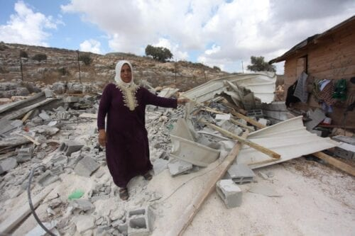 The debris of a building is seen after Israeli security forces demolished a house belonging to Palestinian a family in the West Bank on 10 August 2020 [Nedal Eshtayah/Anadolu Agency]