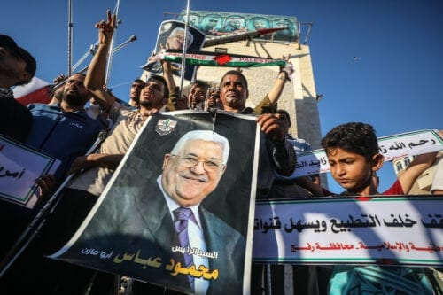 Palestinians hold a poster of Palestinian President Mahmoud Abbas during a protest against the deal between the UAE and Israel in Gaza City, Gaza on 20 August 2020 [Ali Jadallah/Anadolu Agency]