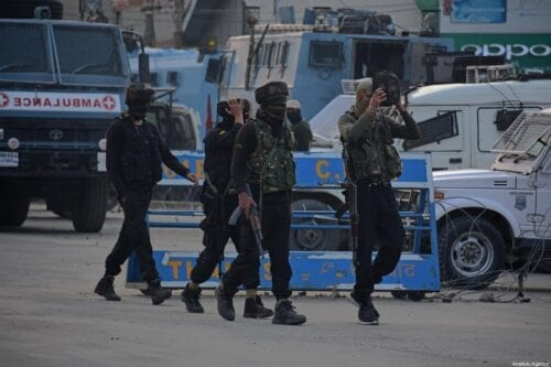 Indian soldiers walk near the site of gun-battle in Pantha Chowk area of Srinagar, Kashmir on August 30, 2020. Three militants and an Assistant Sub Inspector (ASI) of police were killed when encounter broke out between militants and security forces in Pantha Chowk area of Srinagar, police said [Faisal Khan - Anadolu Agency]