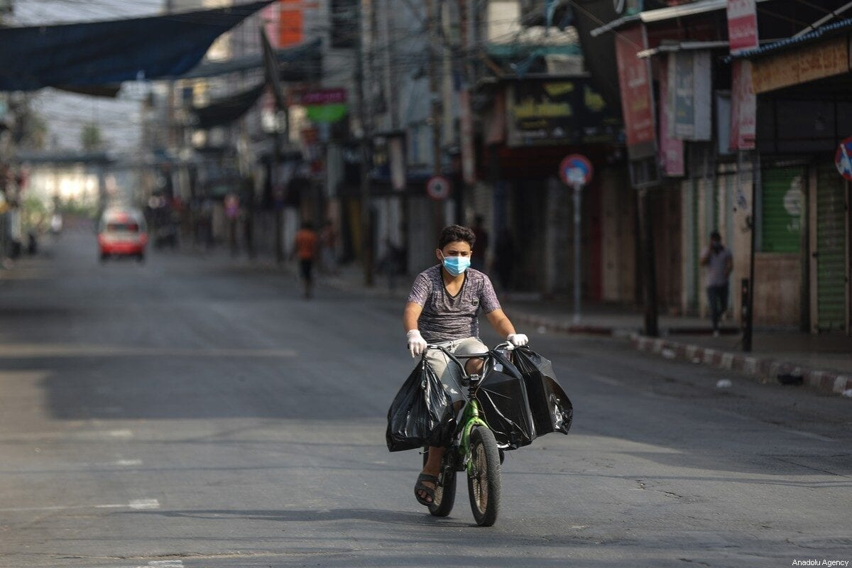 A Palestinian boy seen riding a bicycle in an empty street during the lockdown in Gaza City, Gaza on August 30, 2020 [Ali Jadallah / Anadolu Agency]