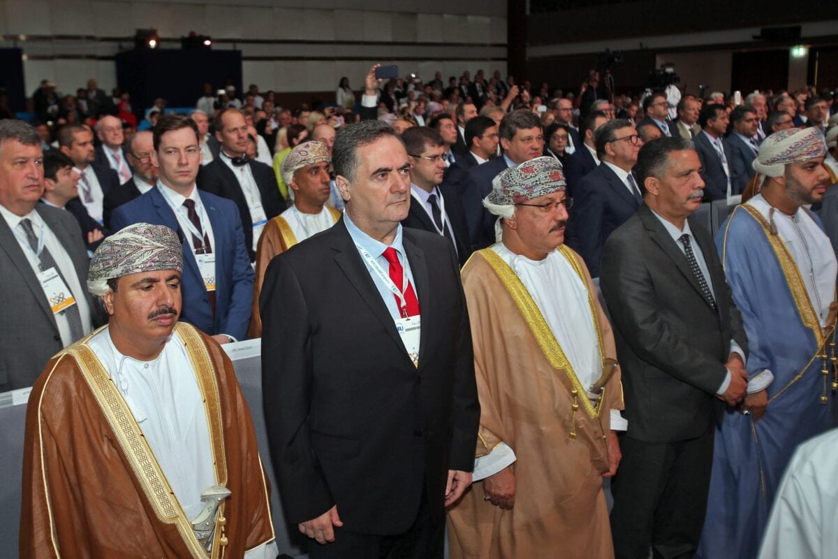 Israeli Minister of Transport Yisrael Katz (2nd-L) stands next to Omani officials during the opening ceremony of the IRU (International Road Transport Union) World Congress in Muscat on November 7, 2018 [MOHAMMED MAHJOUB/AFP via Getty Images]