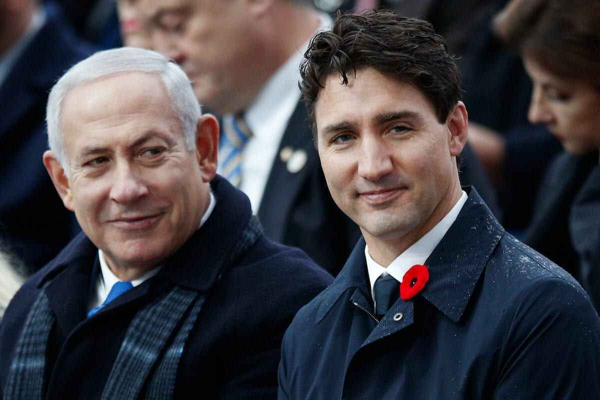Israeli Prime Minister Benjamin Netanyahu (L) and Canadian Prime Minister Justin Trudeau (R) attend a ceremony at the Arc de Triomphe in Paris on 11 November 2018 as part of commemorations marking the 100th anniversary of the 11 November 1918 armistice, ending World War I. [FRANCOIS MORI/AFP via Getty Images]