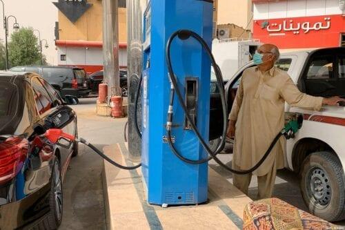 A man refills his car at a gas station in the Saudi capital Riyadh on 11 May 2020 [RANIA SANJAR/AFP/ Getty Images]