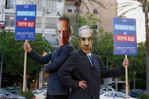 Protesters, wearing masks of Israel's Prime Minister Benjamin Netanyahu and his coalition partner Defence Minister Benny Gantz, take part in a demonstration in Tel Aviv's Rabin Square to denounce Israel's plan to annex parts of the occupied West Bank, on 23 June 2020. [JACK GUEZ/AFP via Getty Images]
