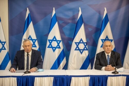 Israeli Prime Minister Benjamin Netanyahu (R) and alternate Prime Minister and Defence Minister Benny Gantz (L) issue a statement at the Israeli Defence Ministry in Tel Aviv on July 27, 2020 [TAL SHAHAR/POOL/AFP via Getty Images]