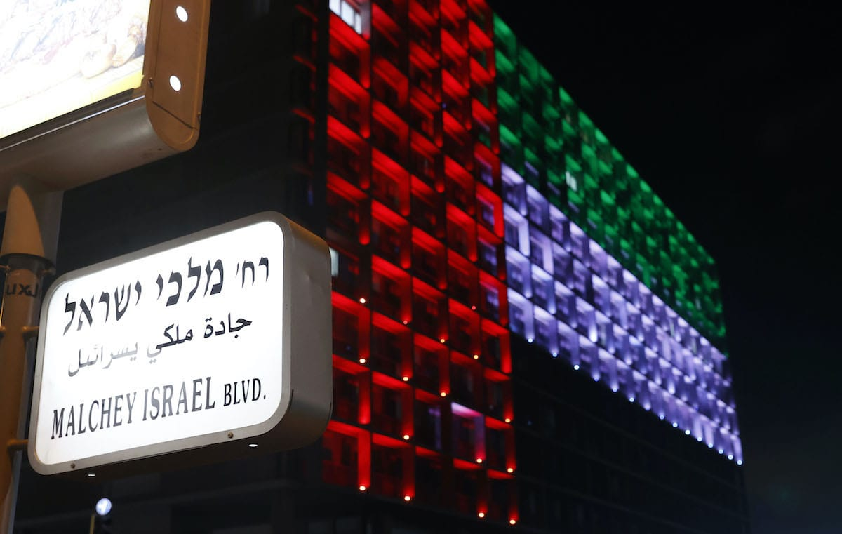 The city hall in the Israeli coastal city of Tel Aviv is lit up in the colours of the United Arab Emirates national flag on August 13, 2020. - Israel and the UAE agreed to normalise relations in a landmark US-brokered deal, only the third such accord the Jewish state has struck with an Arab nation. The agreement, first announced by US President Donald Trump on Twitter, will see Israel halt its plan to annex large parts of the occupied West Bank, according to the UAE. (Photo by JACK GUEZ / AFP) (Photo by JACK GUEZ/AFP via Getty Images)