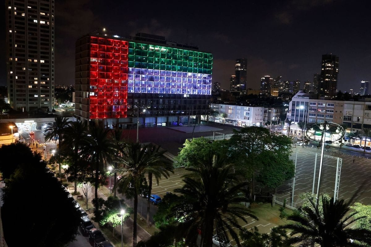 The city hall in the Israeli coastal city of Tel Aviv is lit up in the colours of the United Arab Emirates national flag on August 13, 2020. [JACK GUEZ/AFP via Getty Images]