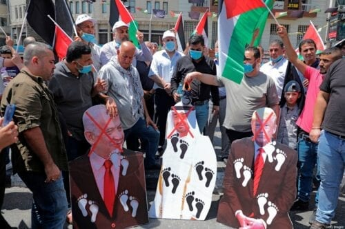 Palestinian protesters prepare to set aflame cut-outs showing the faces of (L to R) Israeli Prime Minister Benjamin Netanyahu, Abu Dhabi Crown Prince Sheikh Mohammed Bin Zayed and US President Donald Trump, during a demonstration in Nablus on 14 August 2020 [JAAFAR ASHTIYEH/AFP/Getty Images]