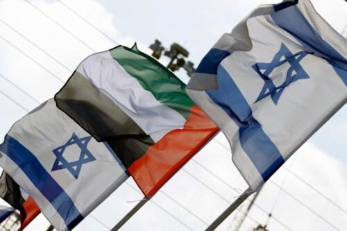 Israeli and United Arab Emirates flags line a road in the Israeli coastal city of Netanya, on August 16, 2020 [JACK GUEZ/AFP via Getty Images]
