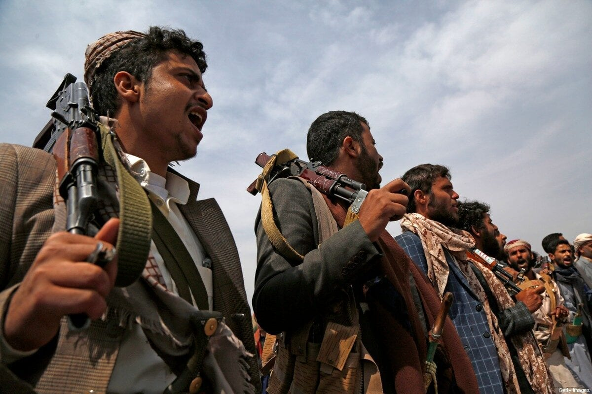 Tribesmen loyal to the Houthi group chant slogans during an armed tribal gathering on 8 July 2020 on the outskirts of Sana'a, Yemen. [Mohammed Hamoud/Getty Images]