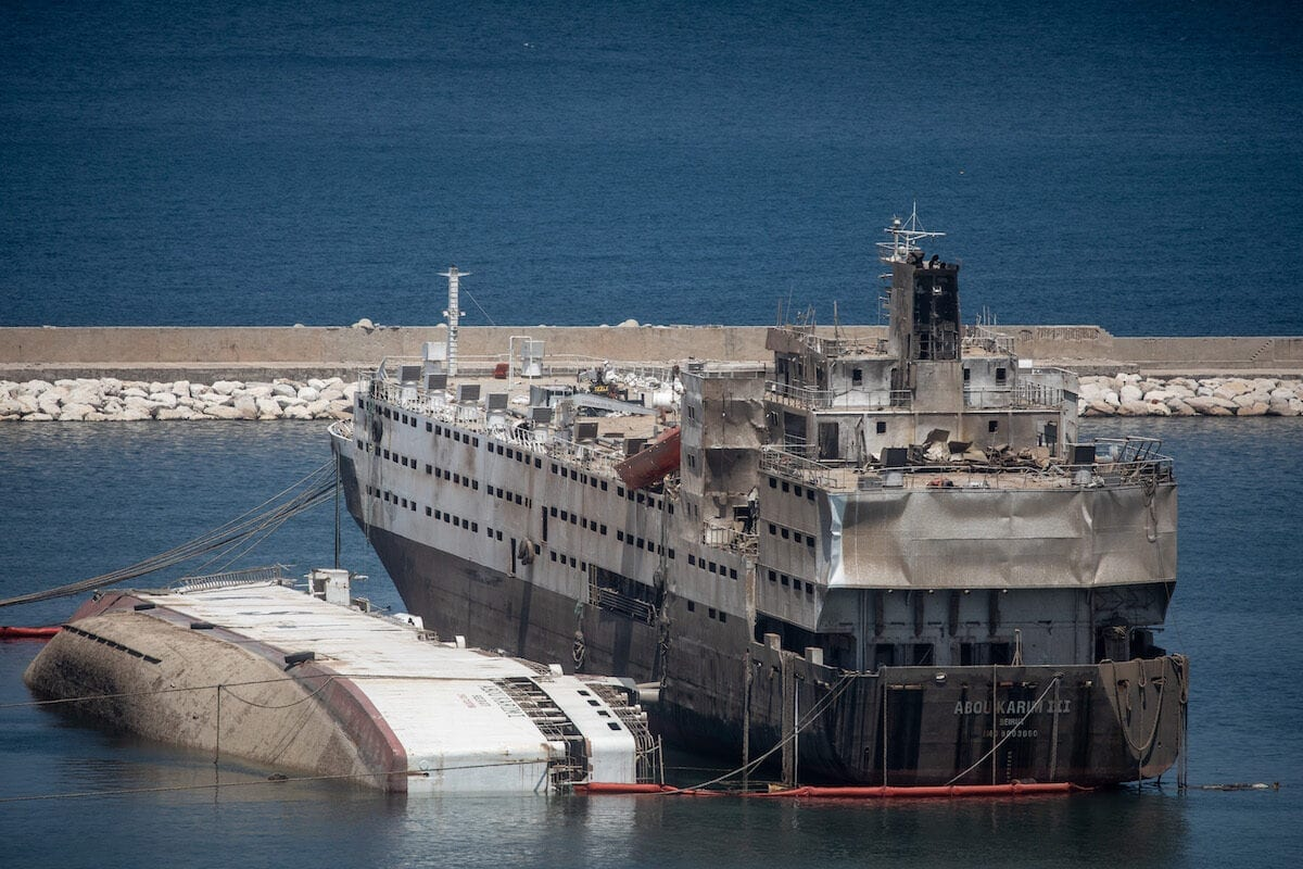 Damaged ships are seen in the Beirut port following an explosion that killed over 200 people in Lebanon, 18 August 2020 [Chris McGrath/Getty Images]