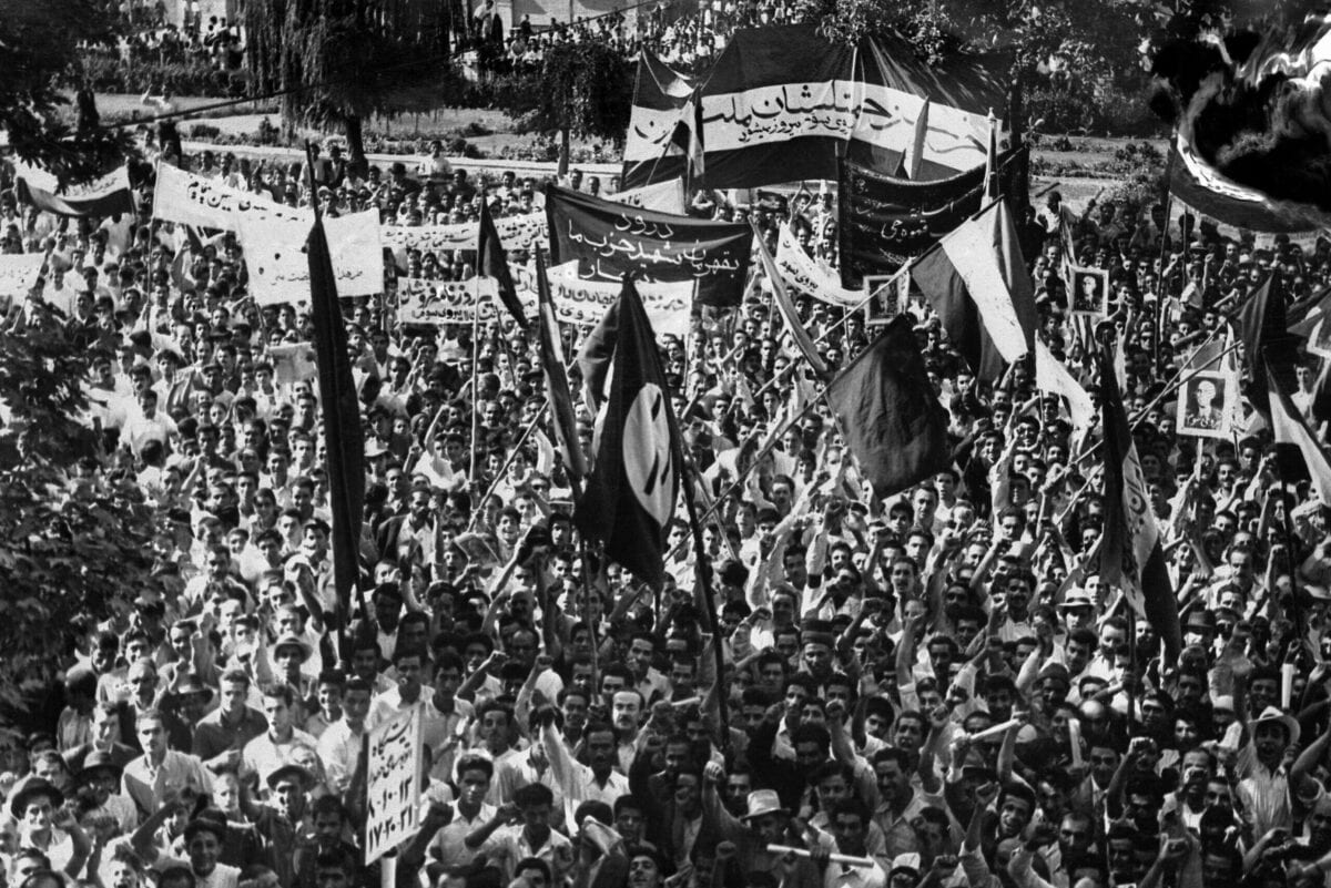 Iranian National Front of Iran (Jebhe Melli) militants demonstrate, 25 July 1953 in Tehran, in support of Prime Minister Mohammed Mossadegh. [-/AFP FILES-INTERCONTINENTALE/AFP via Getty Images]