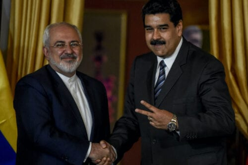 Venezuela's President Nicolas Maduro (R) and Iranian Foreign Minister Mohammad Javad Zarif meet in Caracas on 27 August 2016. [JUAN BARRETO/AFP via Getty Images]