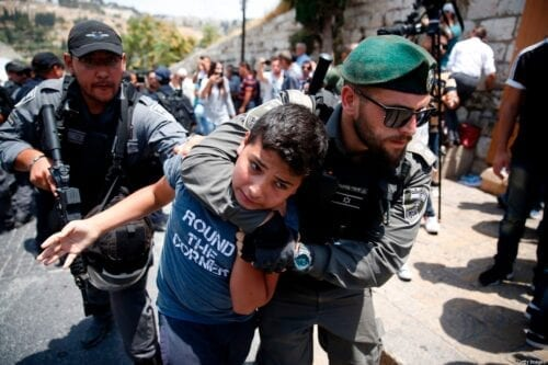 TOPSHOT - Israeli border guards detain a Palestinian youth during a demonstration outside the Lions Gate, a main entrance to Al-Aqsa mosque compound, due to newly-implemented security measures by Israeli authorities which include metal detectors and cameras, in Jerusalem's Old City on July 17, 2017. Israel reopened the ultra-sensitive holy site, after it was closed following an attack by Arab Israeli men in which two Israeli policemen were killed. / AFP PHOTO / AHMAD GHARABLI (Photo credit should read AHMAD GHARABLI/AFP via Getty Images)