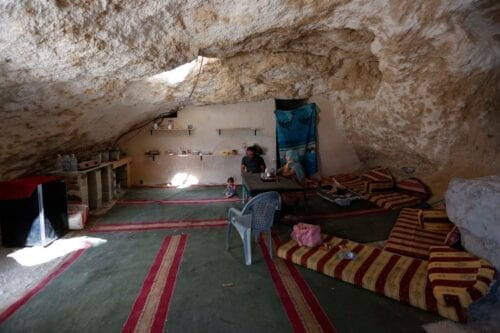 Palestinian Ahmed Amarneh at his home built in cave, in the village of Farasin, in the West Bank on 11 August 2020 [Shadi Jarar'ah/ApaImages]
