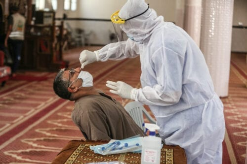 A health worker, affiliated to Palestinian Health Ministry, collects a nasal swab sample for a coronavirus (COVID-19) polymerase chain reaction (PCR) test in Gaza City, Gaza on September 21, 2020 [Ali Jadallah - Anadolu Agency]