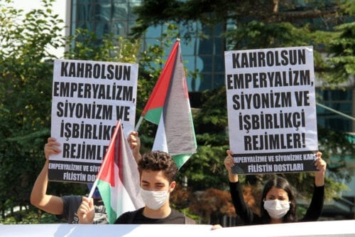 A group of people gather to stage a protest against normalisation deals with Israel in Istanbul, Turkey on 25 September 2020 [Mehmet Eser/Anadolu Agency]