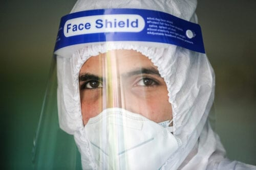 Officials of Health Ministry wearing a face shield on September 25, 2020 [Ali Jadallah/Anadolu Agency]